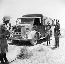 280px-A_British_infantryman_takes_the_surrender_of_the_crew_of_an_enemy_supply_truck_in_the_Western_Desert,_2_June_1942._E12810