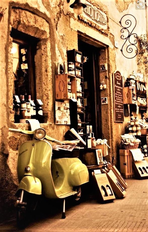 Le botteghe vintage una bella bottega classica, con una bella vespa.